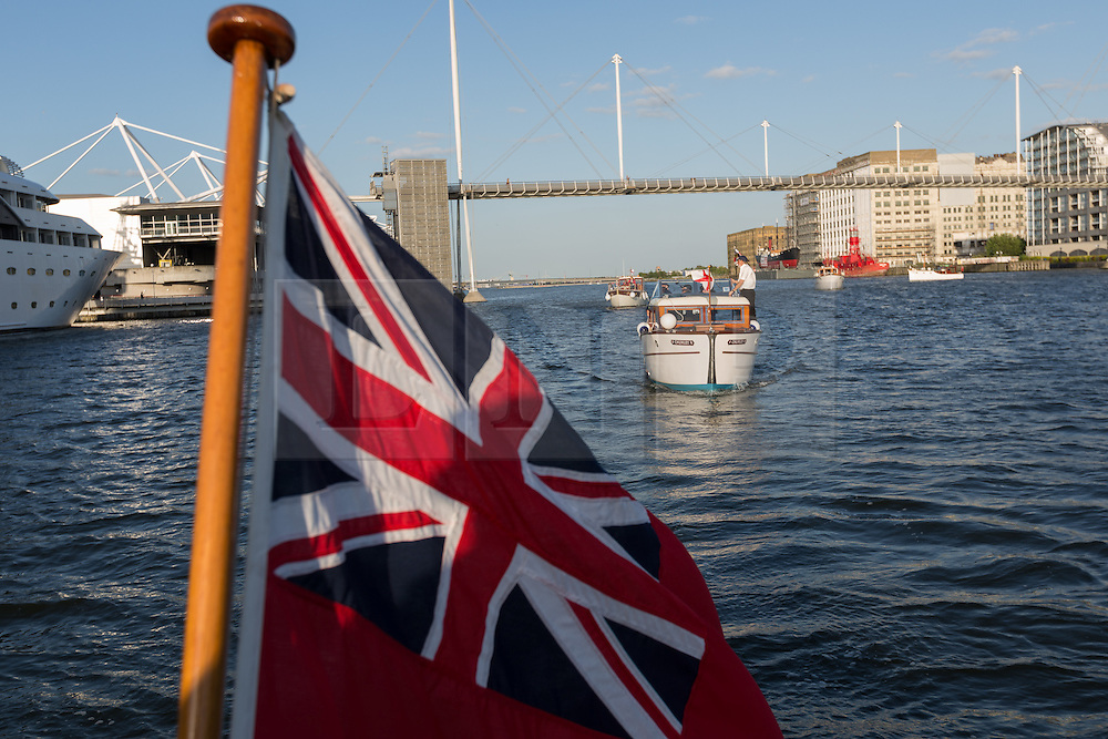 © Licensed to London News Pictures. 16/05/2015. London, UK. Dunkirk Little ships arrive in Royal Victoria Dock this evening. Over 20 Dunkirk Little Ships have gathered in London toay before leaving in the morning to continue their journey to Dunkirk to mark the 75th anniversary of the Dunkirk Evacuations. Photo credit : Vickie Flores/LNP