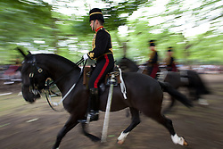 © Licensed to London News Pictures. 23/07/2013. London, UK. Gunners of the King's Troop Royal Artillery gallop to fire a 41 gun salute in Green Park, London, today (23/07/2013) to mark the birth of a new Royal Baby who was born yesterday to the Duke and Duchess of Cambridge at the Lindo Wing of St Mary's Hospital in Paddington, London. Photo credit: Matt Cetti-Roberts/LNP