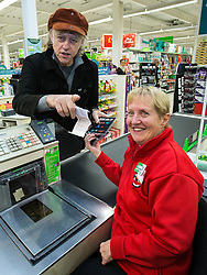 © Licensed to London News Pictures . 08/12/2014 . Manchester , UK . SIR BOB GELDOF buys copies of the Band Aid 30 CD at a branch of Asda in Trafford Park , Manchester , this morning ( 8th December 2014 ) for the CD launch of Band Aid 30 . Photo credit : Joel Goodman/LNP