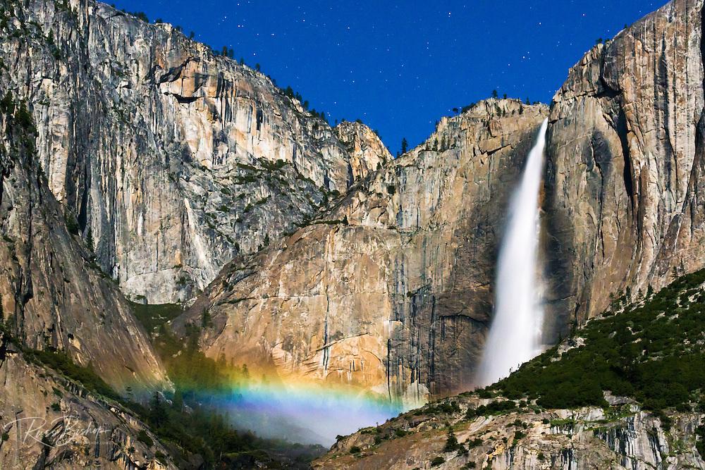 Moonbow and starry sky over Yosemite Falls, Yosemite National Park, California USA