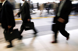 Motion blur image of commuters walking to work in Tokyo Japan