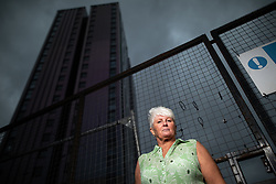 © Licensed to London News Pictures . 12/10/2018. Salford , UK . Thorn Court resident DAWN LEWIS (57) outside her flat . Recently installed cladding at several council-owned tower blocks in Salford has been identified as having similar dangerous properties to that which was installed on the Grenfell Tower in London . Residents have been waiting months for clarification on what action will be taken to make their homes safe . Photo credit : Joel Goodman/LNP