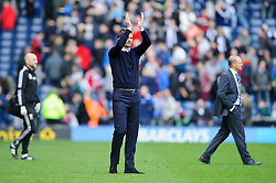 Manager Tim Sherwood (ENG) of Tottenham Hotspur applauds the travelling support after his side rescue a 3-3 draw, as Manager Pepe Mel (ESP) of West Brom walks past behind - Photo mandatory by-line: Rogan Thomson/JMP - 07966 386802 - 12/04/2014 - SPORT - FOOTBALL - The Hawthorns Stadium - West Bromwich Albion v Tottenham Hotspur - Barclays Premier League.
