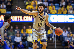 Jan 19, 2019; Morgantown, WV, USA; West Virginia Mountaineers guard Jermaine Haley (10) calls out a play during the second half against the Kansas Jayhawks at WVU Coliseum. Mandatory Credit: Ben Queen-USA TODAY Sports