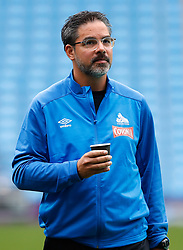"""Huddersfield Town manager David Wagner inspects the pitch before the Premier League match at the Etihad Stadium, Manchester. PRESS ASSOCIATION Photo. Picture date: Sunday August 19, 2018. See PA story SOCCER Man City. Photo credit should read: Martin Rickett/PA Wire. RESTRICTIONS: EDITORIAL USE ONLY No use with unauthorised audio, video, data, fixture lists, club/league logos or """"live"""" services. Online in-match use limited to 120 images, no video emulation. No use in betting, games or single club/league/player publications."""