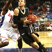 University of Central Florida guard A.J. Rompza (3) dribbles the ball past Erving Walker (11) while taking on the Florida Gators at the Amway Center on December 1, 2010 in Orlando, Florida. Central Florida won the game 57-54 for their first ever victory against a nationally ranked team. (AP Photo/Alex Menendez)