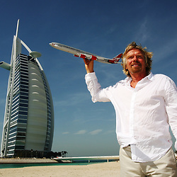 PIC BY PAUL GROVER IN DUBAI WHERE VIRGIN ATLANTIC FLEW FOR THE FIRST TIME ON ITS DUBAI INAUGURAL PIC SHOWS RICHARD BRANSON ON THE BEACH AT THE BURJ AL ARAB HOTEL PIC PAUL GROVER