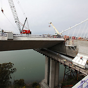 The San Francisco-Oakland Bay Bridge is under construction, and scheduled to open Labor Day 2013. The Self-Anchored Suspension Span (SAS) is the largest bridge of its kind in the world measuring 2,047 feet. This engineering and construction marvel raises the bridge building bar to new heights, as seen in these behind the scenes photos taken on Monday, March 18, 2013. (AP Photo/Alex Menendez)