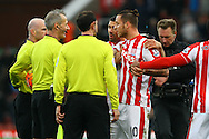 Marko Arnautovic of Stoke City (10) has words with referee Martin Atkinson after the game.  Barclays Premier league match, Stoke city v Manchester city at the Britannia Stadium in Stoke on Trent, Staffs on Saturday 5th December 2015.<br /> pic by Chris Stading, Andrew Orchard sports photography.
