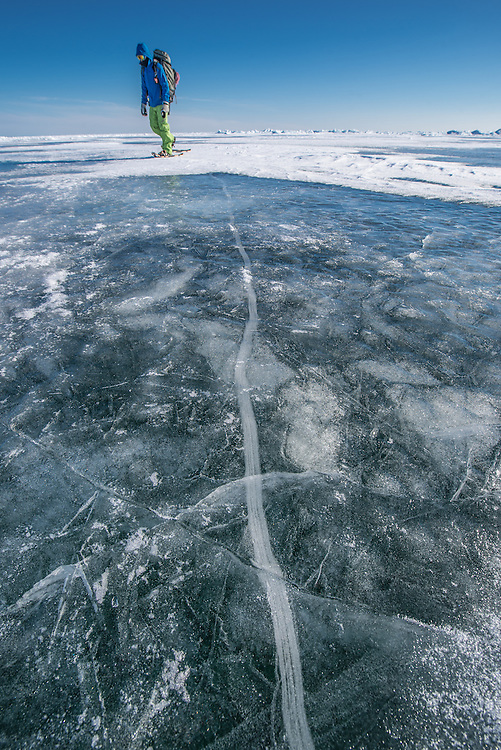 WHILE SNOWSHOEING TO OUR NEXT LOCATION WE COULD OBSERVE CREATIVE ICE LINE ON THE SURFACE OF THE FROZEN LAKE.