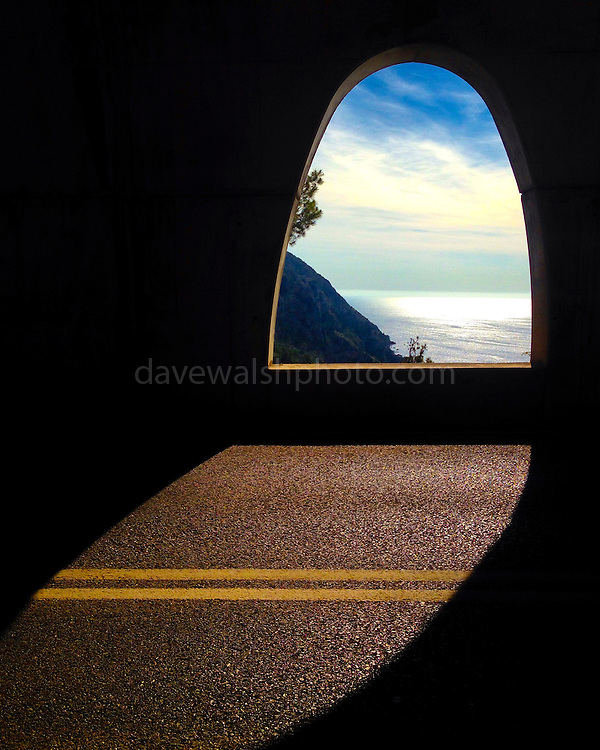 """View of the Mediterranean Sea through a road tunnel in Mallorca, near Estellencs. This mage can be licensed via Millennium Images. Contact me for more details, or email mail@milim.com For prints, contact me, or click """"add to cart"""" to some standard print options."""