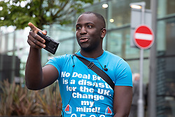 © Licensed to London News Pictures. 09/07/2019. Salford, UK. FEMI OLUWOLE joins a pro EU demonstration outside the studio . Boris Johnson and Jeremy Hunt attend a televised hustings at Media City. One of the two will be the next Conservative Party Leader and British Prime Minister. Photo credit: Joel Goodman/LNP