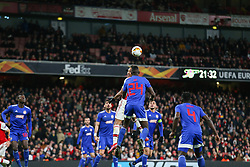 Pierre-Emerick Aubameyang of Arsenal jumps with Ousseynou Ba of Olympiacos - Mandatory by-line: Arron Gent/JMP - 27/02/2020 - FOOTBALL - Emirates Stadium - London, England - Arsenal v Olympiacos - UEFA Europa League Round of 32 second leg