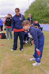 Young disabled girl taking part in Mini games sports event held at Stoke Mandeville Stadium,