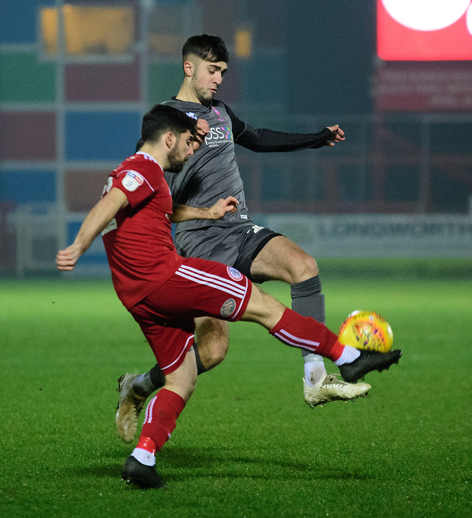 Lincoln City's Ellis Chapman vies for possession with Accrington Stanley's Piero Mingoia<br /> <br /> Photographer Andrew Vaughan/CameraSport<br /> <br /> The EFL Checkatrade Trophy Second Round - Accrington Stanley v Lincoln City - Crown Ground - Accrington<br />  <br /> World Copyright © 2018 CameraSport. All rights reserved. 43 Linden Ave. Countesthorpe. Leicester. England. LE8 5PG - Tel: +44 (0) 116 277 4147 - admin@camerasport.com - www.camerasport.com