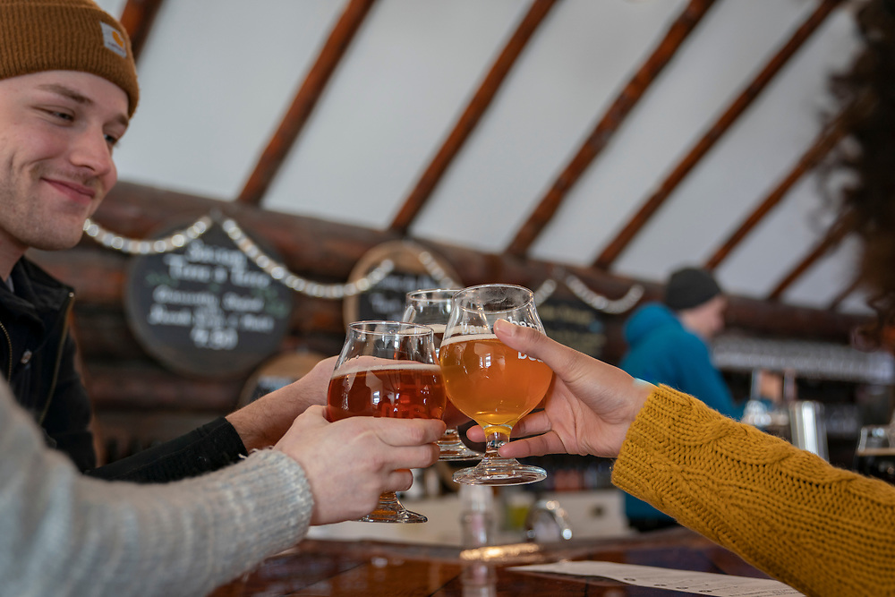 Friends gather at Barrel and Beam Brewery in Marquette, Michigan.