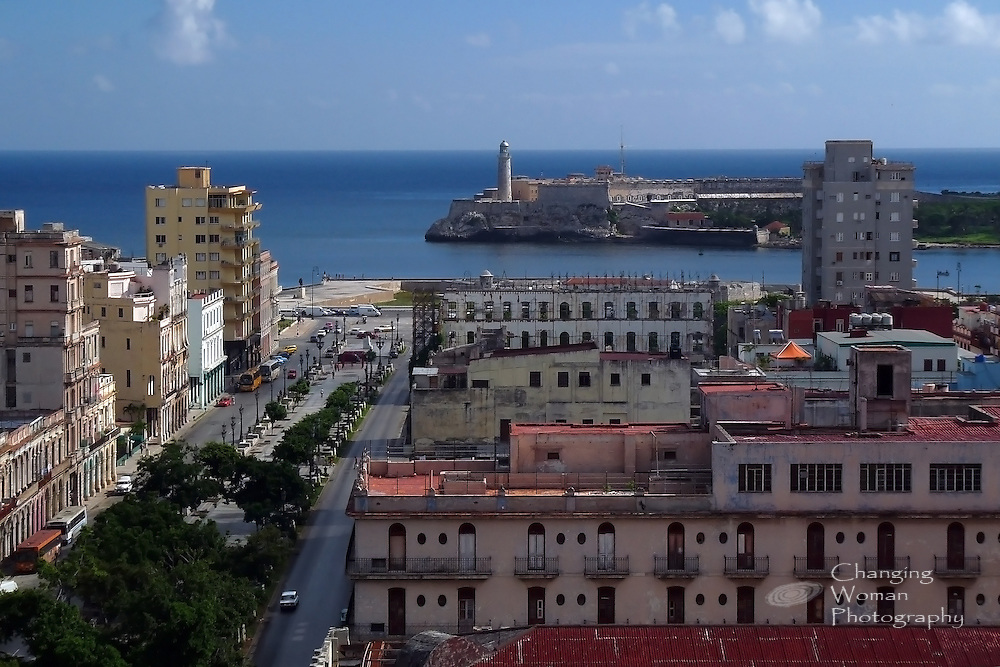 Havana, Cuba, cityscape features famous landmarks: El Prado, the tree-lined promenade bordered by Paseo del Prado and Paseo de Martí connecting downtown with El Malecón, the beach drive, and a view of historical El Morro guarding Havana Bay.