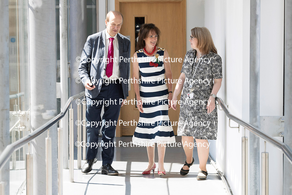 Muscular Dystrophy UK visit to the Biomedical Sciences Research Complex, St Andrews University…<br />Pictured from left on a tour of the facility are Robert Meadowbank Chief Exec MDUK, Lady Diana Lindsay and Dr Judith Sleeman<br />Picture by Graeme Hart.<br />Copyright Perthshire Picture Agency<br />Tel: 01738 623350  Mobile: 07990 594431