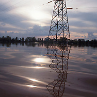 Electrical tower in flooded field, low light. Accession #: 0.00.379.001.08