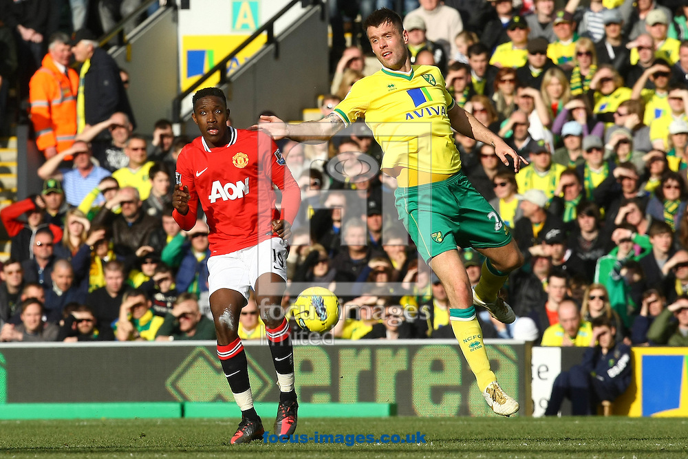 Picture by Paul Chesterton/Focus Images Ltd.  07904 640267.26/02/12.Danny Welbeck of Man Utd and Elliot Ward of Norwich in action during the Barclays Premier League match at Carrow Road Stadium, Norwich.