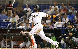 June 13, 2017 - Miami, FL, USA - The Miami Marlins' Marcell Ozuna follows through on a solo home run during the fourth inning against the Oakland Athletics at Marlins Park in Miami on Tuesday, June 13, 2017. The Marlins won, 8-1. (Credit Image: © David Santiago/TNS via ZUMA Wire)