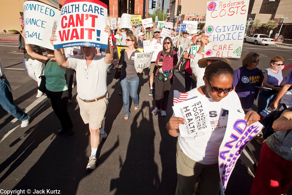 17 AUGUST 2009 -- PHOENIX, AZ: A crowd marching in favor of health care reform cross 3rd Street at Washington downtown. About 5,000 people were expected to demonstrate in favor of President Obama's health care proposals. Nearly 1,500 showed up to demonstrate against the President.  PHOTO BY JACK KURTZ