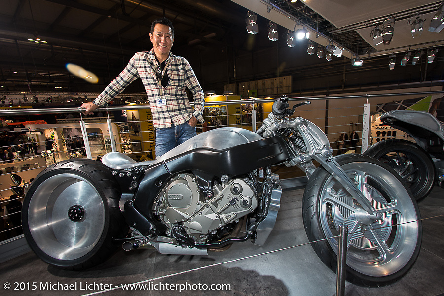 Custom bike builder Ken Nagai of Ken's Factory in Tokyo with his BMW custom commission at EICMA, the largest international motorcycle exhibition in the world. Milan, Italy. November 17, 2015.  Photography ©2015 Michael Lichter.