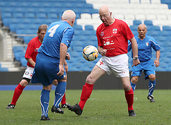 England's Tommy Charlton (right) challenges Italy's Vito Gibin on his England debut during the Walking Football International match at The AMEX Stadium, Brighton.