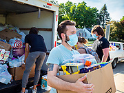 25 JUNE 2020 - DES MOINES, IOWA: A Black Lives Matter supporter helps unload a truck of supplies for the homeless donated to BLM. Nearly 100 volunteers came to a community support event organized by Black Lives Matter in Good Park in Des Moines. They sorted supplies donated to BLM, including food, sanitary supplies, first aid supplies, batteries, blankets, tents, and bottled water. The emergency packages will be distributed to homeless people in Des Moines.        PHOTO BY JACK KURTZ