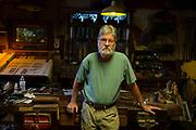 Senior man standing in workshop
