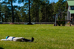March 22, 2019 - Raeford, North Carolina, US - March 23, 2019 - Raeford, N.C., USA - WILLIAM COLEMAN of the United States relaxes in front of the Tobacco Barn complex before the start of the cross country CCI-4S division at the sixth annual Cloud 11-Gavilan North LLC Carolina International CCI and Horse Trial, at Carolina Horse Park. The Carolina International CCI and Horse Trial is one of North AmericaÃ•s premier eventing competitions for national and international eventing combinations, hosting International competition at the CCI2*-S through CCI4*-S levels and National levels of Training through Advanced. (Credit Image: © Timothy L. Hale/ZUMA Wire)