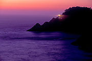 Image of Heceta Head Lighthouse on cliff at dusk overlooking the Pacific Ocean, near Florence, Oregon, Pacific Northwest by Randy Wells