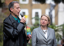 © Licensed to London News Pictures. 01/05/2015. London, UK. Campaigner Peter Tatchell and Natalie Bennett, centre, launch the Green Party's LGBTIQ manifesto in Soho Square, central London. Ms Bennett announced Green pledges to review the discriminatory blood ban and introduce LGBTIQ-inclusive sex education. Photo credit: LNP