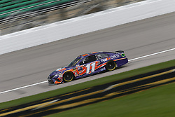 October 19, 2018 - Kansas City, Kansas, United States of America - Denny Hamlin (11) hangs out in the garage during practice for the Hollywood Casino 400 at Kansas Speedway in Kansas City, Kansas. (Credit Image: © Justin R. Noe Asp Inc/ASP via ZUMA Wire)