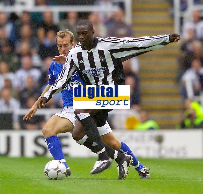 Photo. Jed Wee<br /> Newcastle United v Birmingham City, FA Barclaycard Premiership, St. James' Park, Newcastle. 30/08/2003.<br /> Birmingham's Jamie Clapham (L) tries to keep tabs on Newcastle's Shola Ameobi.