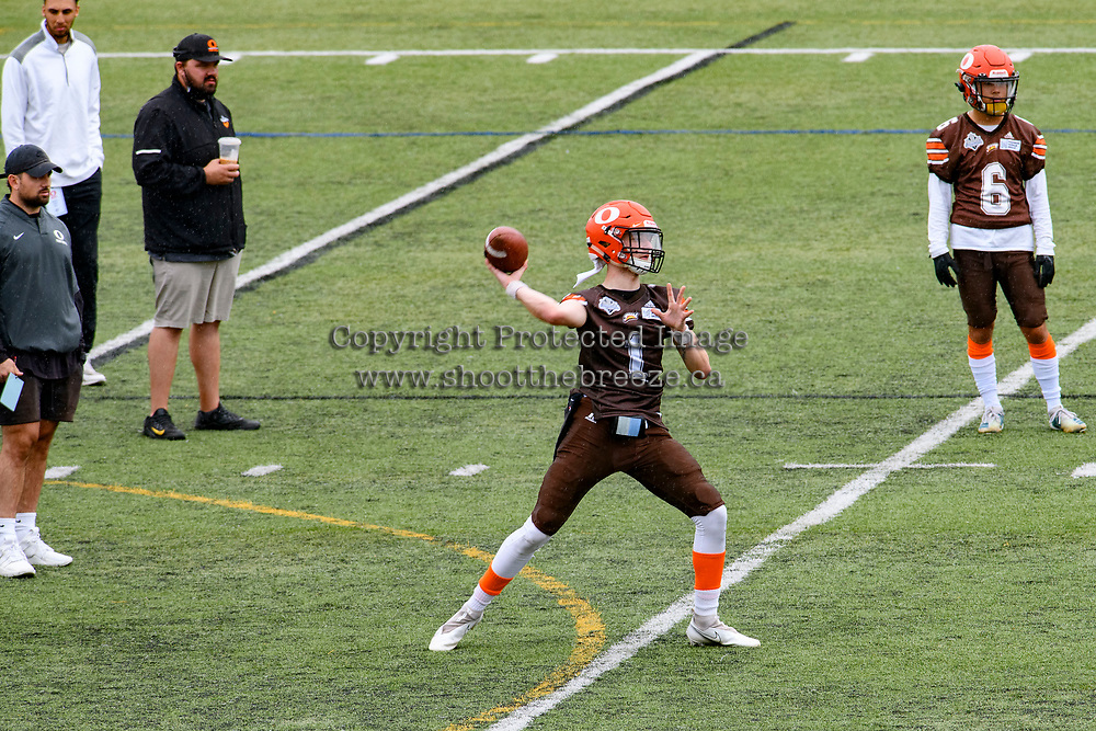 CHILLIWACK, BC - SEPTEMBER 11: Alex Douglas #1 of Okanagan Sun throws the ball during warm up against the Westshore Rebels at Exhibition Stadium in Chilliwack, BC, Canada. (Photo by Marissa Baecker/Shoot the Breeze)