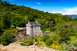 Aerial view from drone of  view of Saddell Castle on Saddell Bay in Kintyre peninsula, Argyll and Bute, Scotland, Uk