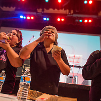 050915       Cable Hoover<br /> <br /> Amanda Martza, right, Alberta Kallestewa and Paula Gonzalez compete in a taco-eating contest at El Morro Theatre during ArtsCrawl in downtown Gallup Saturday. Martza won the $100 prize by eating six tacos in three minutes.