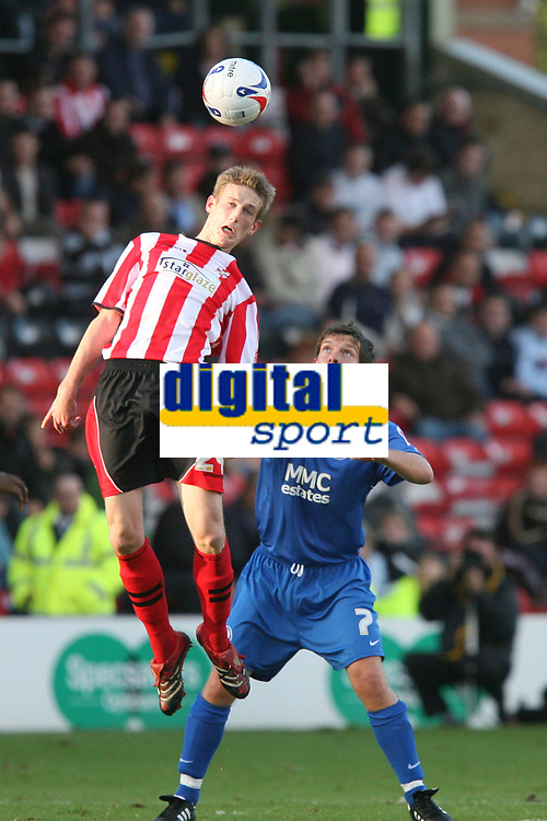 Photo: Pete Lorence.<br />Lincoln City v Rochdale United. Coca Cola League 2. 21/10/2006.<br />Lincoln's Jeff Hughes leaps over a helpless Darrell Clarke.