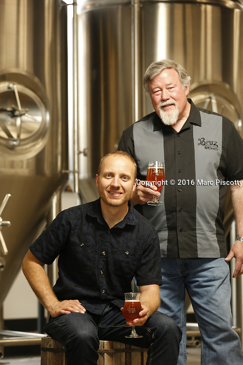 SHOT 7/22/16 2:16:57 PM - Bruz Beers co-founders Charlie Gottenkieny and Ryan Evans inside the new brewery near 67th Avenue and Pecos in Denver, Co. Bruz Beers is Denver's artisanal Belgian-style brewery, featuring a full line of traditional and Belgian-inspired brews, hand-crafted in small batches. Includes images of Evan's dog 'Cooper' as well who serves as the brewery dog. (Photo by Marc Piscotty / © 2016)