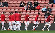 Manchester United players including Manchester United Phil Jones warm up during the Barclays U21 Premier League match between U21 Southampton and U21 Manchester United at the St Mary's Stadium, Southampton, England on 25 April 2016. Photo by Phil Duncan.