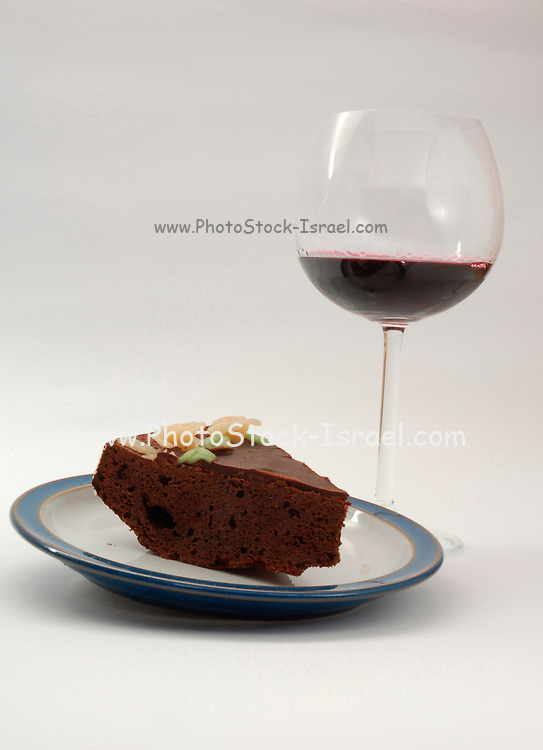 Birthday cake, a slice of chocolate cake and a glass of red wine