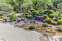 """Yukinoniwa Garden - The garden of Myomanji named Yuki-no-niwa or """"snow garden"""" was built by Matsunaga Teitoku. In its heyday it was called one of the three best gardens in Kyoto that had the combination of: snow, moon and flowers.  There is a fine washitsu tatami room from which to admire the garden. Yukinoniwa Garden has been compared to Jojuin garden - a sub-temple of Kiyomizudera. Myomanji temple grounds are made up of islands of raked gravel.  Additionally there is a tower, as well as a large stupa which is a copy of Bodh Gaya in India where Buddha gained Enlightenment."""