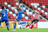 Sunderland midfielder Chris Maguire (7) shoots at goal during the EFL Sky Bet League 1 match between Sunderland and Shrewsbury Town at the Stadium Of Light, Sunderland, England on 23 January 2021.