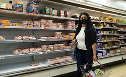 © Licensed to London News Pictures. 11/09/2021. London, UK. A shopper wearing a face covering in Iceland supermarket in north London. Next week, Prime Minister Boris Johnson will announce new measures such as mandatory masks in indoor settings such as shops and restaurants if Covid-19 cases continue to rise over autumn. Photo credit: Dinendra Haria/LNP