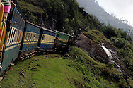 The last surviving steam powered train as it enters a tunnel near Ooty, Tamil Nadu India..