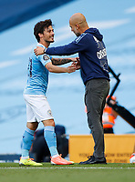 Football - 2019 / 2020 Premier League - Manchester City vs Norwich City<br /> <br /> Manchester City Manager Josep Guardiola and David Silva of Manchester City at the Etihad Stadium.<br /> <br /> COLORSPORT/LYNNE CAMERON