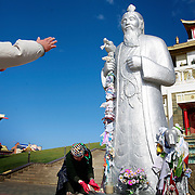 A Buddhist prays at a newly built temple in Elista, capital of the southern Russian republic Kalmykia. ..The US$25-million temple was built by millionaire president of the republic, Kirsan Ilyumzhinov...Critics have decried the building as a white-elephant in a state mired in poverty...Ilyumzhinov, 44, who is also the president of the World Chess Federation, Fide, is hosting one of the world?s most important matches in history. ..The match beginning September 21 in Elista, the capital of Europe?s only Buddhist nation, will end a 13-year split in the game that has produced rival claims to the title. ..Veselin Topalov, a Bulgarian ranked first according to Fide, will play against Vladimir Kramnik, who is the Classical Chess World Champion, a title established after Garry Kasparov led a breakaway from Fide in 1993. The two grandmasters, both aged 31, will face each other for the right to be undisputed world chess champion...A Buddhist millionaire businessman, Ilyumzhinov acquired his wealth in the economic free-for-all which followed the collapse of the Soviet Union. ..At the age of just over 30, he was elected president in 1993 after promising voters $100 each and a mobile phone for every shepherd. Soon after, he introduced presidential rule, concentrating power in his own hands. ..He denies persistent accusations of corruption, human rights abuses and the suppression of media freedom. When Larisa Yudina, editor of the republic's only opposition newspaper and one of his harshest critics, was murdered in 1998, he strenuously rejected allegations of involvement. ..Mr Ilyumzhinov has been president of the International Chess Federation (FIDE) since 1995 and has been enthusiastic about attracting international tournaments to Kalmykia. His extravagant Chess City has led to protests by its impoverished citizens. ....