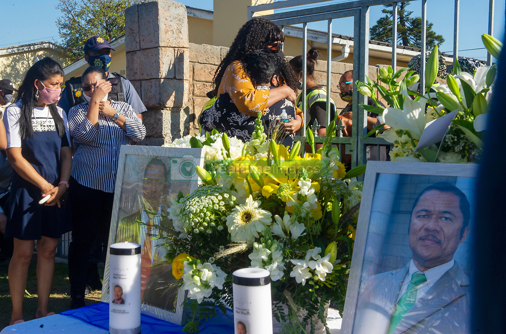ANAPix - South Africa - Cape Town - Wife of Charl Kinnear in dark glasses being consoled by a family member. A memorial service organised by the Bishop Lavis CPF(Community Police Forum) is held for Lt/Col Charl Kinnear. The AGU(Anti-Gang unit section commander) was gunned down in front of his home in Bishop Lavis, Gearing road. A suspect is currently in custody for questioning. The community came out in their numbers to attend. Picture/vid Courtney Africa/African News Agency(ANA)