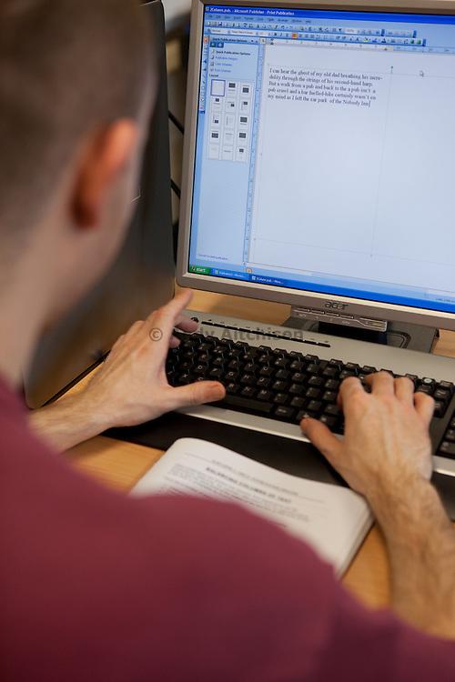 A prisoner working on a computer. HMP The Mount, Bovingdon, Hertfordshire